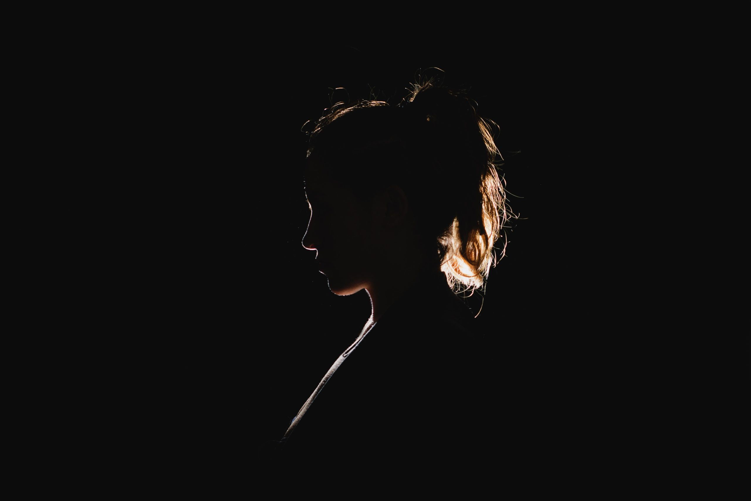 a black silhouette of a woman